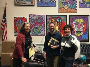 Board Member Anne Llewellyn and colleague Robin Boltz meet with Rep. Lois Frankel (FL-22-D) Legislative Director Ian Wolf to discuss the National Nurse Act 2019